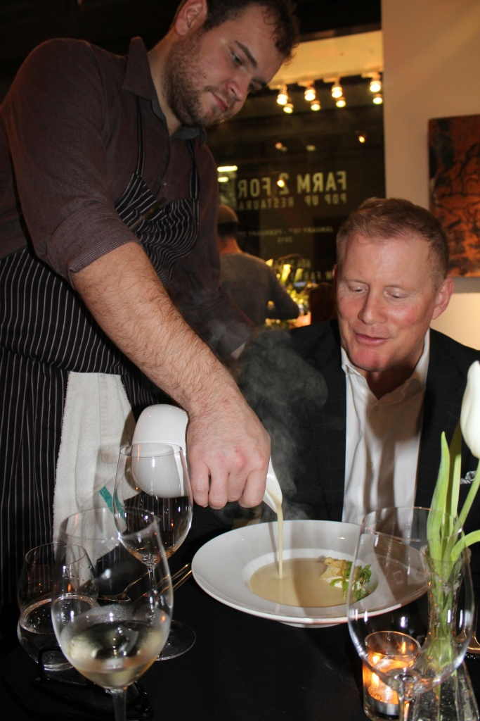 Executive Chef Nicolas Hipperson releasing  the Veloute, for guest Ray Matthews.  Photo Credit: Deanna Beaudoin